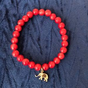 Red bead bracelet with elephant charm